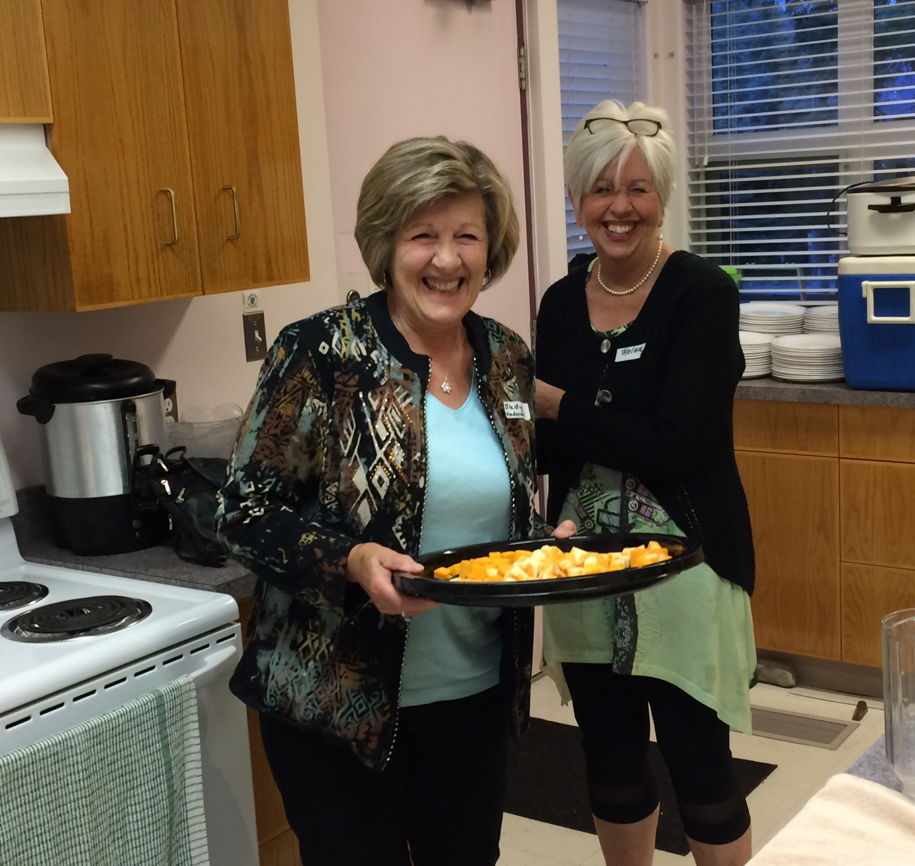 Judy Frain & Helen Franken prepare the feast